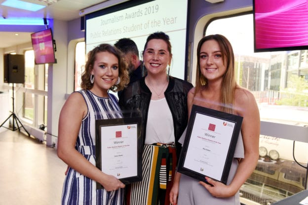 photograph of Lorna with students presenting awards