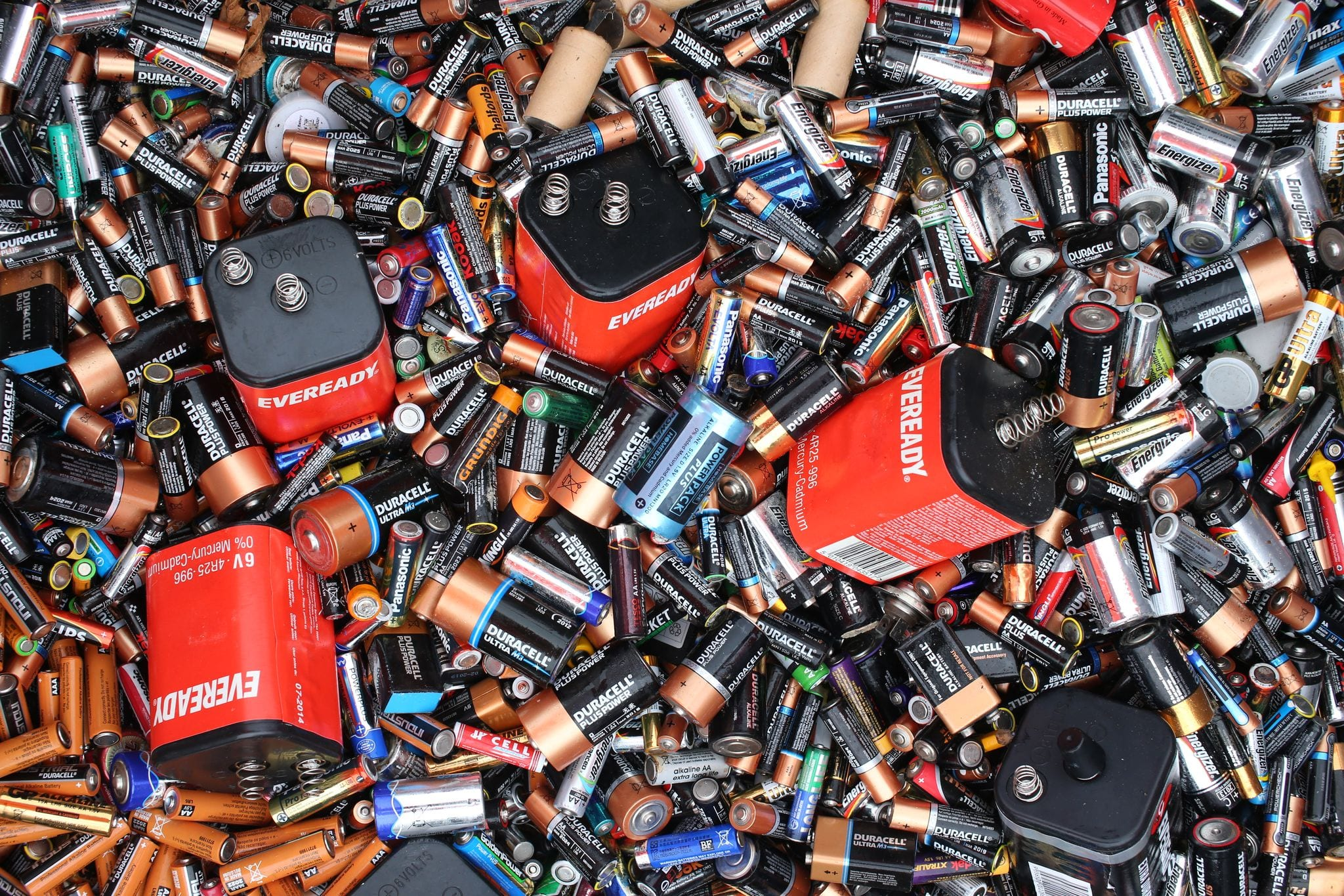 Photograph of many different types of used batteries
